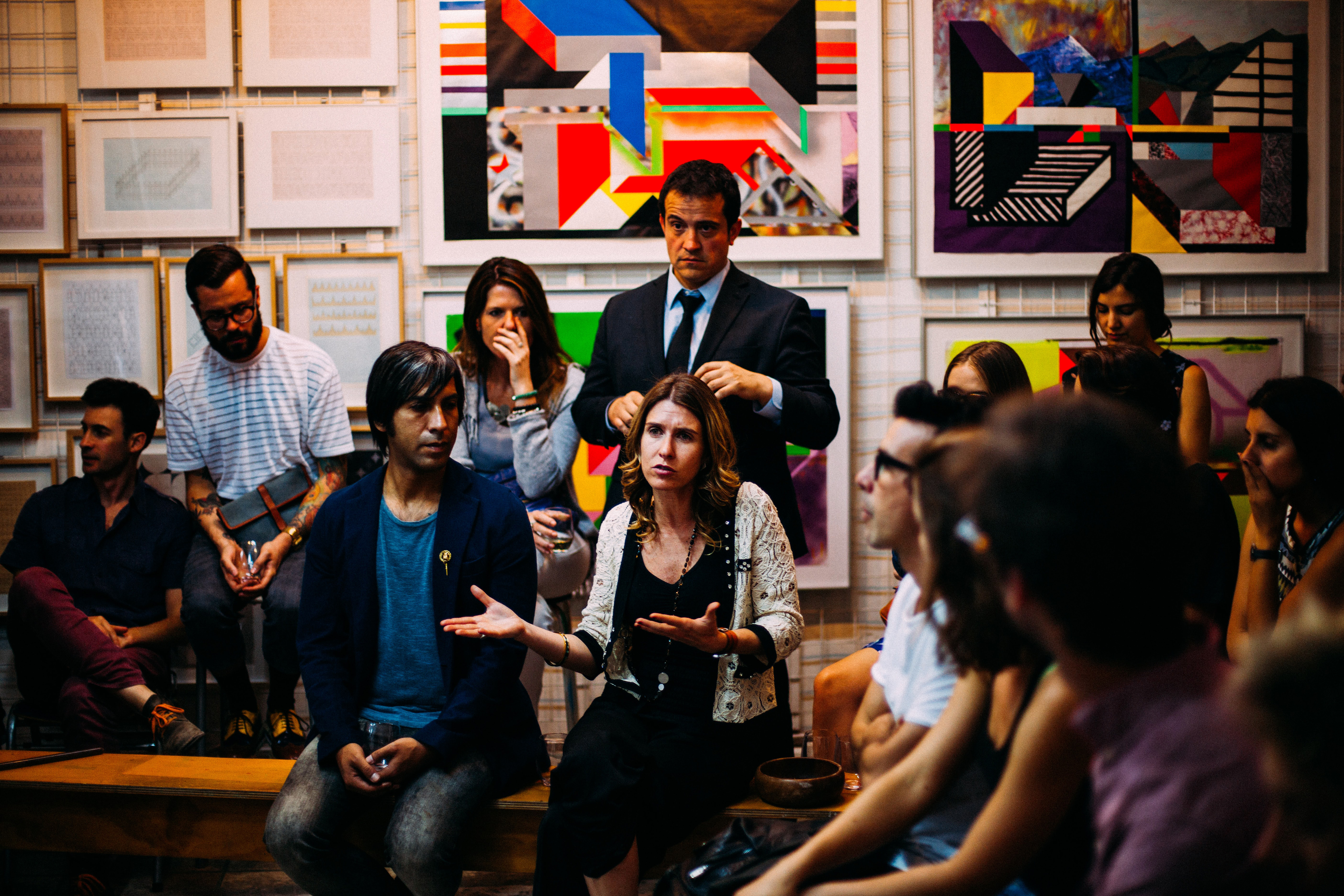 A group of young adults holding a discussion